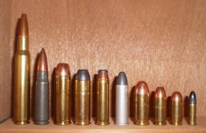 Comparison of rifle and handgun cartridges.  From left to right: two common rifle cartridges: .30-06, 7.62×39mm.  Seven handgun cartridges: .454 Casull, .45 Colt, .357 Magnum, .38 Special, .45 ACP, 9mm, .380 ACP.  Far right: .22 Long Rifle, common in both rifles and handguns.  Wikimedia Commons / public domain.